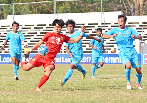 Shan United striker Kim Hyun Woo thunders a powerful volley during a match against Hantharwady on April 7 in Taungoo stadium. He scored leading goal for Shan. Photo - Shan United