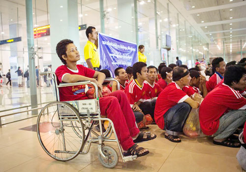 A file photo of Myanmar workers at the Yangon International Airport who returned home last year. Nyan Zay Htet / The Myanmar Times