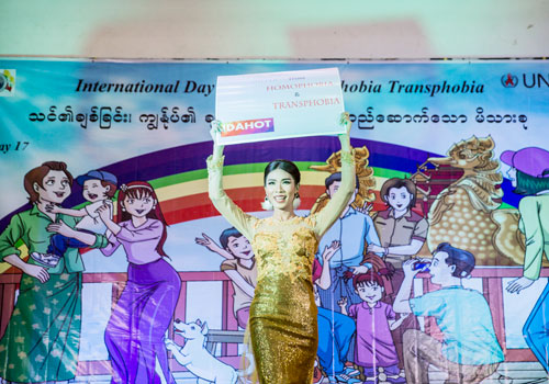 A woman holds a sign advocating for LGBT rights. Zarni Phyo / The Myanmar Times