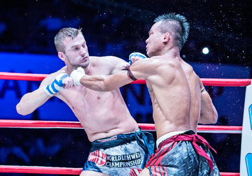 Artur Saladiak of Poland and local favourite Soe Lin Oo in action in the light middleweight division on Saturday at the Thuwana Indoor Stadium. Saladiak won on points. Zarni Phyo / The Myanmar Times
