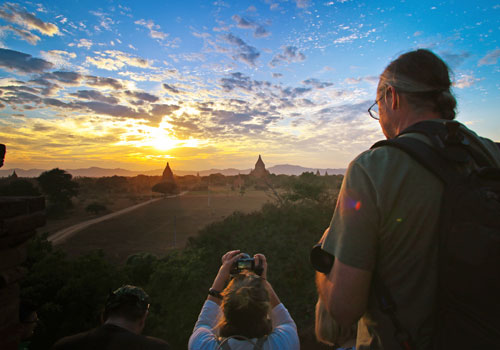 A file photo of a tourist taking photographs in Bagan. Thiri Lu / The Myanmar Times
