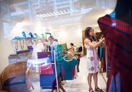 'We Burmese really care about our own ethnic and traditional clothes,' says Pyone Thet Thet Kyaw, right, of Virya Couture fashion outlet in Yangon. Photo - AFP