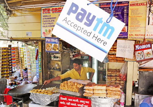 An Indian street food vendor displays a sign board indicating that mobile phone payment is accepted. Photo - EPA