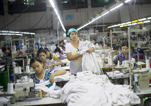 A file photo of women working at the Shweyi Zabe garment factory in Shwe Pyi Thar Industrial Zone in Yangon. Photo - AFP
