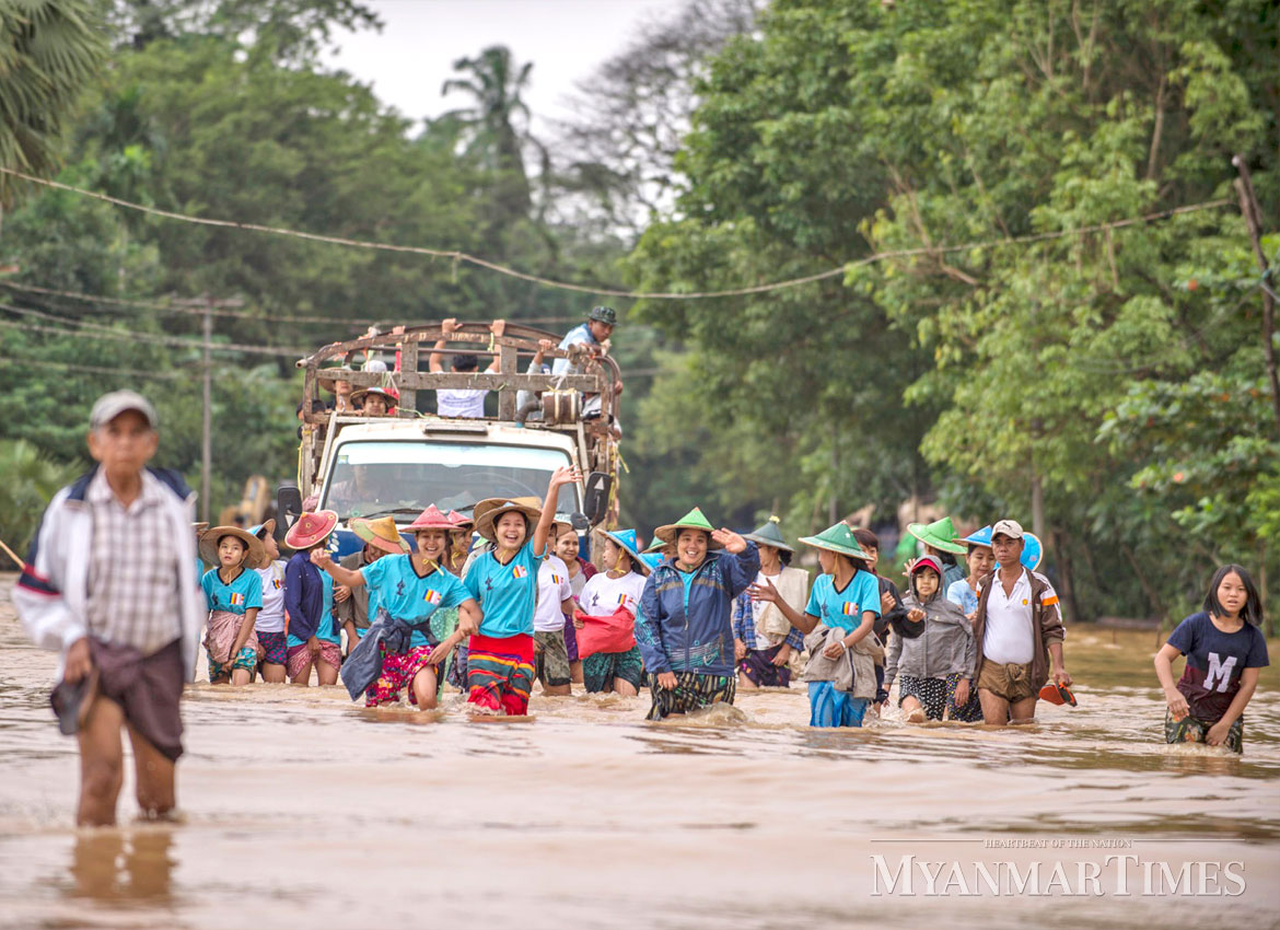 Five dead nearly 100000 displaced by myanmar floods the myanmar volunteers arrive in bilin township on sunday to aid victims kaung hthetthe myanmar altavistaventures Gallery