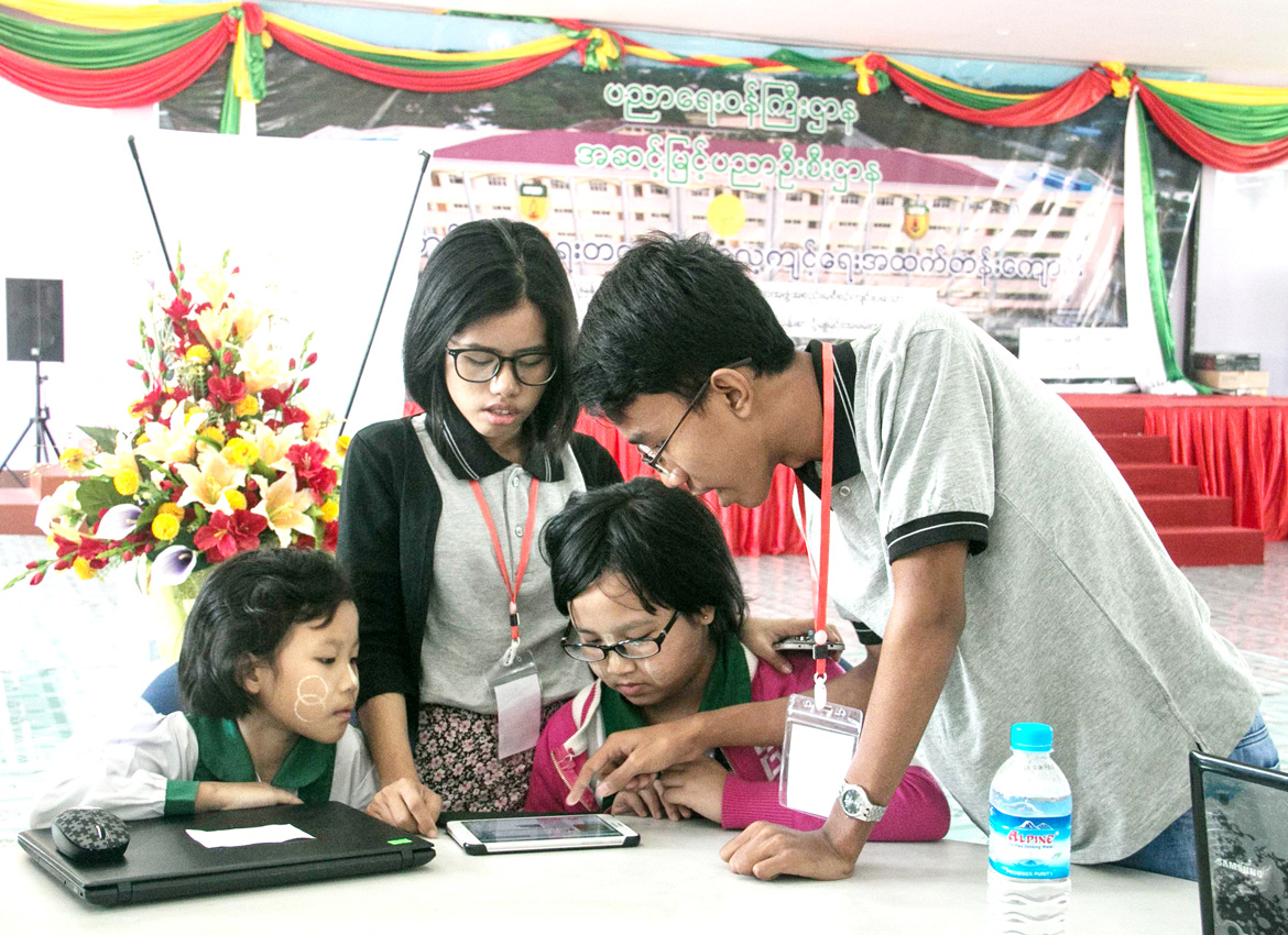 Myanmar STEM staff teach basic computer programming to students on Tuesday. Phoe Wa/The Myanmar Times