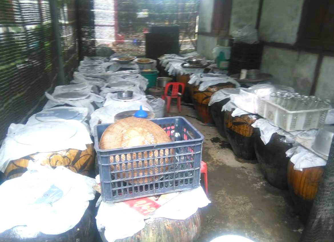 WiangMaw's fermentation vats for traditional toddy palm wine.