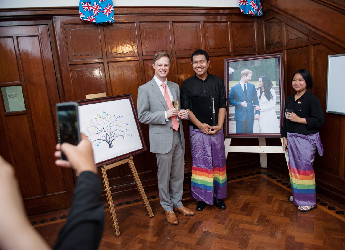 Britain's Deputy Ambassador David Hall poses for a photo with members of the &PROUD LGBT Choir at the British Ambassador's residence in Yangon. Aung Khant/The Myanmar Times