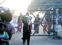 A file image of people walking past a police checkpoint in Rakhine. Photo - EPA