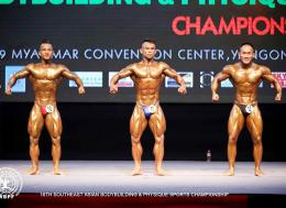 Contestants in the 55kg category flex their muscles during the 16th SE Asian Body Building and Physique Sports championship 2019 at MCC Hall in Yangon, Myanmar on May 16, 2019.  Photo - WBPF