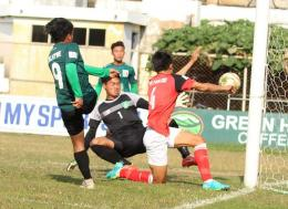 Junior Lions players (in green) try to defend against a Myawady striker's attack during the match between Myawady and the Junior Lions at Pandomar Stadium in Yangon on Saturday. Photo - MNL