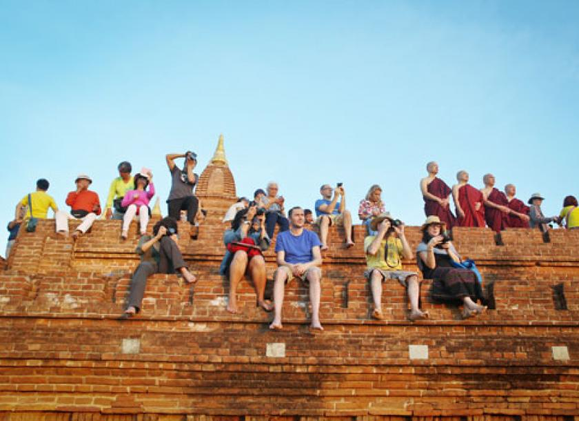 Why myanmars tourist numbers dont add up the myanmar times tourists and myanmar visitors watch the sun set from the top of a temple at bagan altavistaventures Gallery