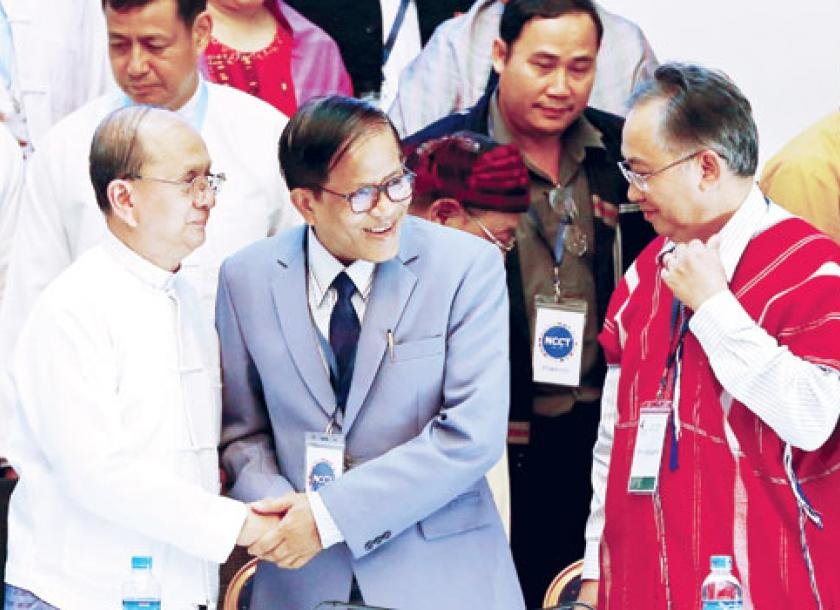 Tracking the evolution of an historic peace process the myanmar times president u thein sein shakes hands with ethnic negotiator naing han thar after they signed the platinumwayz