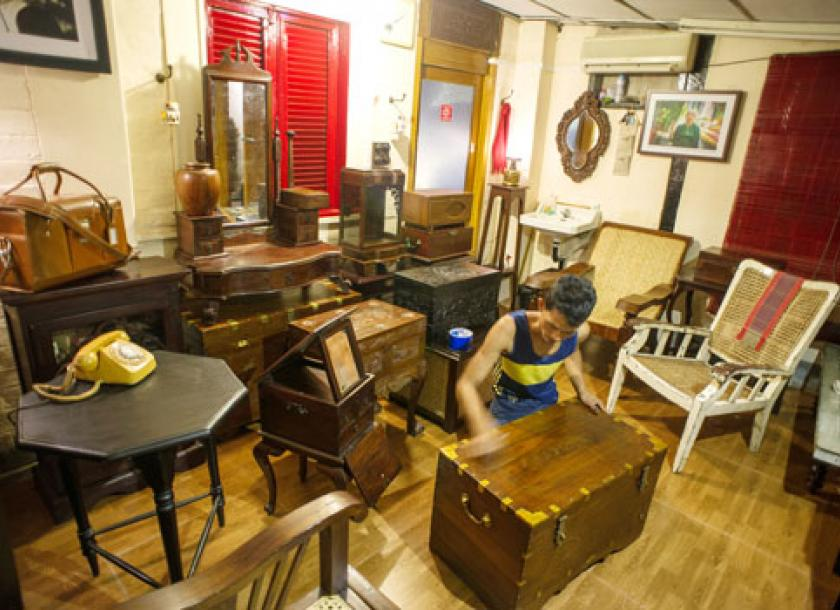 A Man Polishes A Teak Chest At The AVA Antiques And Collectibles Showroom.  Photos: