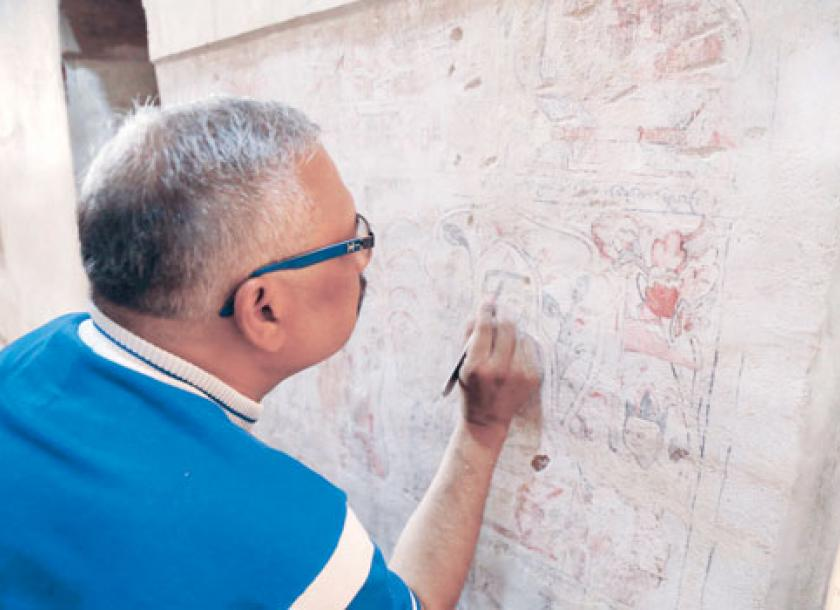 An Indian Archaeologist Exposes A Mural Found Last Month Under 5  Centimetres Of Lime On A
