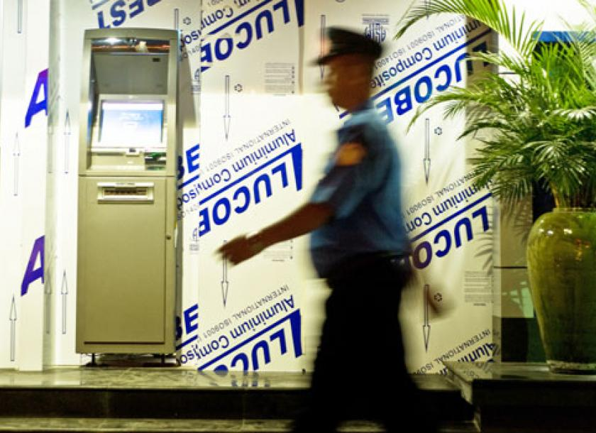 A Security Guard Walks Past An ATM In Downtown Yangon Photo Kaung Htet