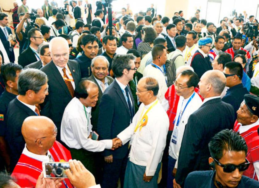 Key players to miss peace conference the myanmar times president u thein sein centre greets diplomats during a nationwide ceasefire agreement ceremony in platinumwayz