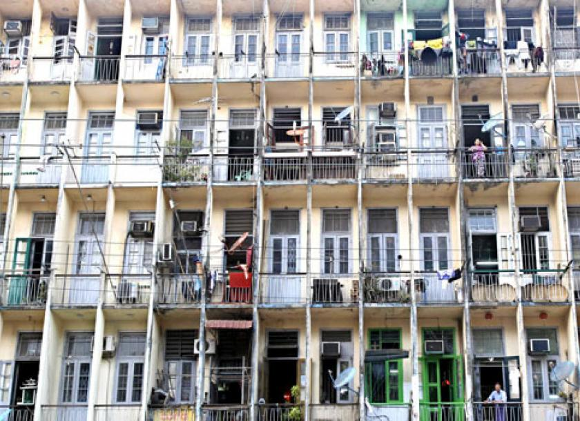 Exceptionnel People Look Out From On Their Balconies In A Crowded Apartment Building In  Downtown Yangon.