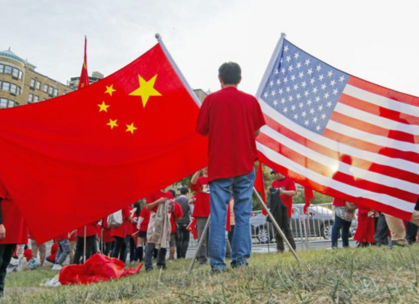 A File Photo Of Spectators With Chinese And Us National Flags Gather In Washington Beijing