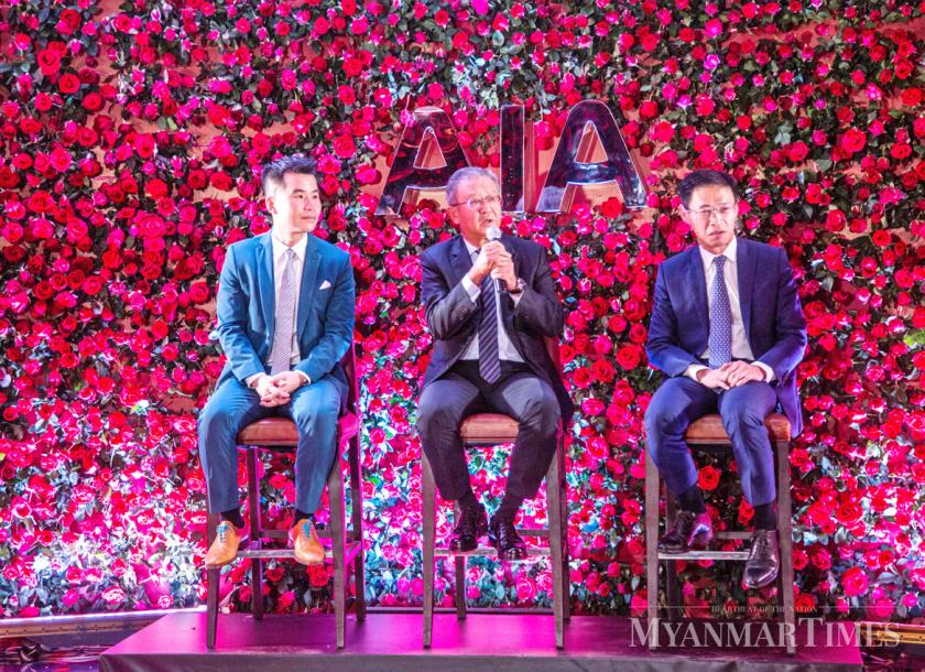 From left: Nhon Ly, AIA Myanmar CEO, Ng Keng Hooi, AIA group chief executive and president and U Zaw Naing, secretary of the Insurance Business Regulatory Board. Nyan Zay Htet/The Mynamar Times