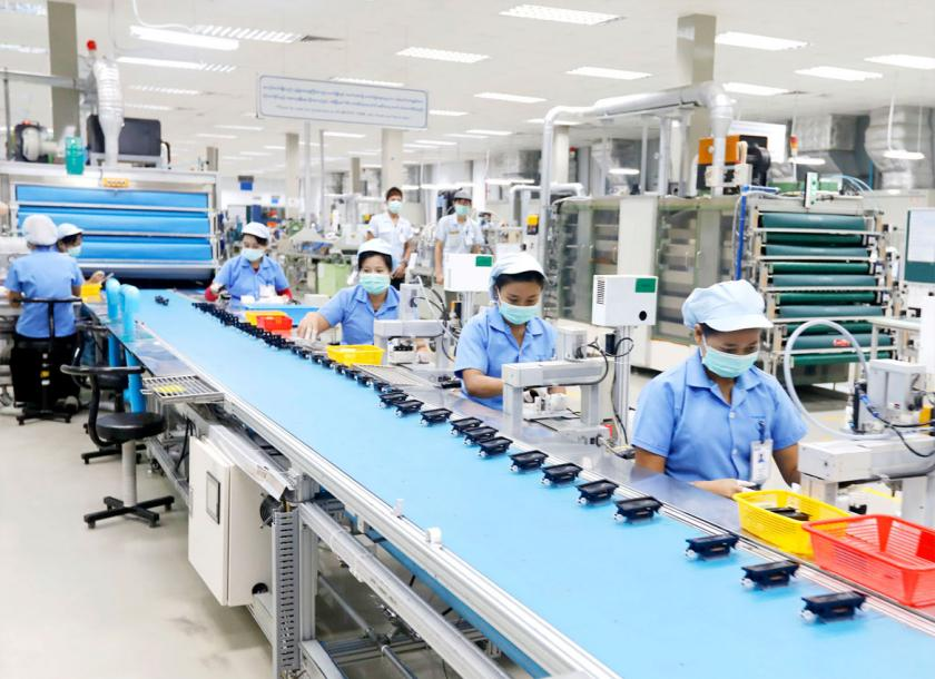 A file photo of workers in an electronics plant set up by foreign investors in Myanmar. Photo - EPA