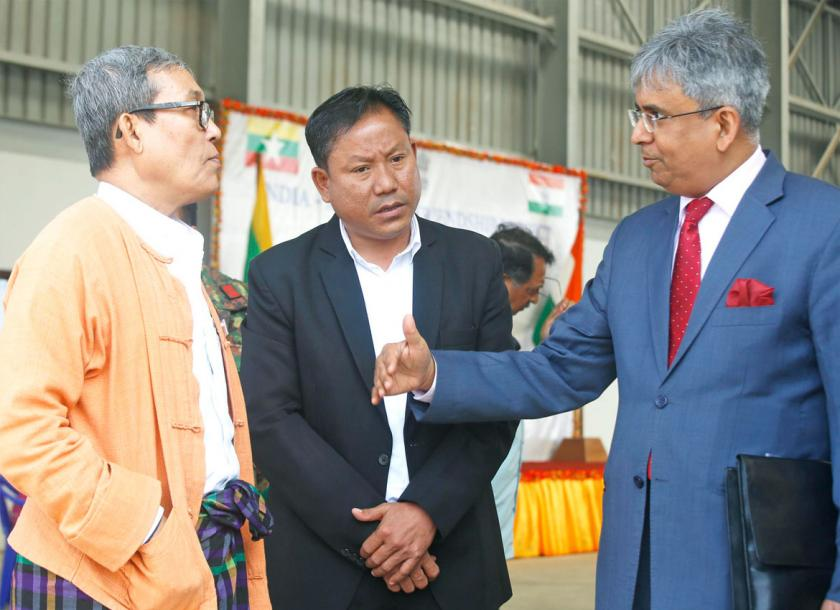 Rakhine State chief minister Nyi Pu (L) and Indian Ambassador to Myanmar, Saurabh Kumar (R) talk prior to the ceremony for the handover of relief materials to the government of Rakhine State, in Sittwe. Photo - EPA