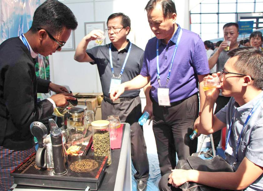 A man serves Myanmar tea at his booth at the Myanmar Pavilion expo. Ei Shwe Phyu/ The Myanmar Times