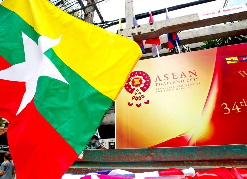 A Myanmar flag was seen in front of the banner of the 34th ASEAN Summit earlier this year. Photo: EPA