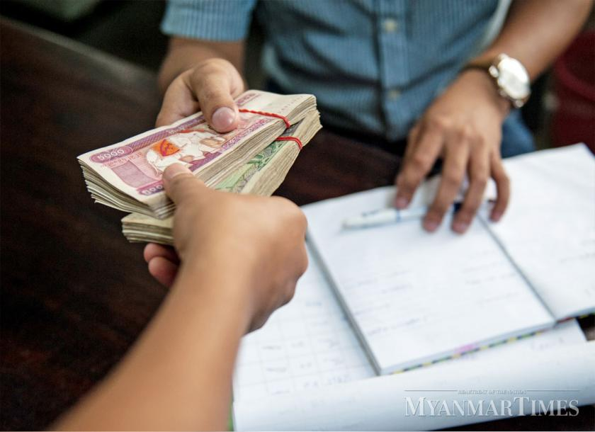 The Unle Exchange Rate Between Myanmar Kyat And Us Dollar Has Spurred Central