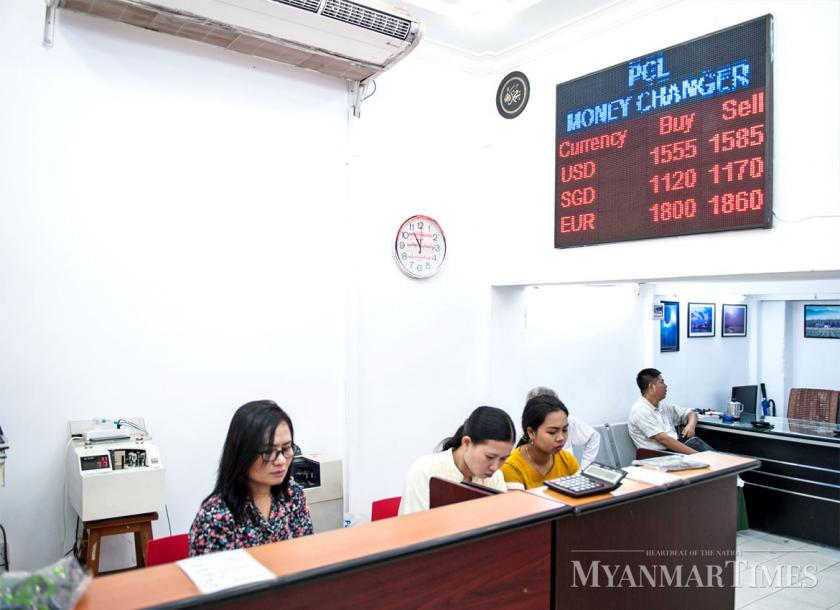 Money Changers Work At A Currency Exchange In Downtown Yangon On Monday Aung Khant