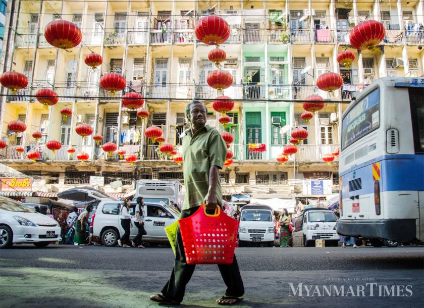A man carries the baskets in downtown Yangon. Ko Ko Htay/The Myanmar Times