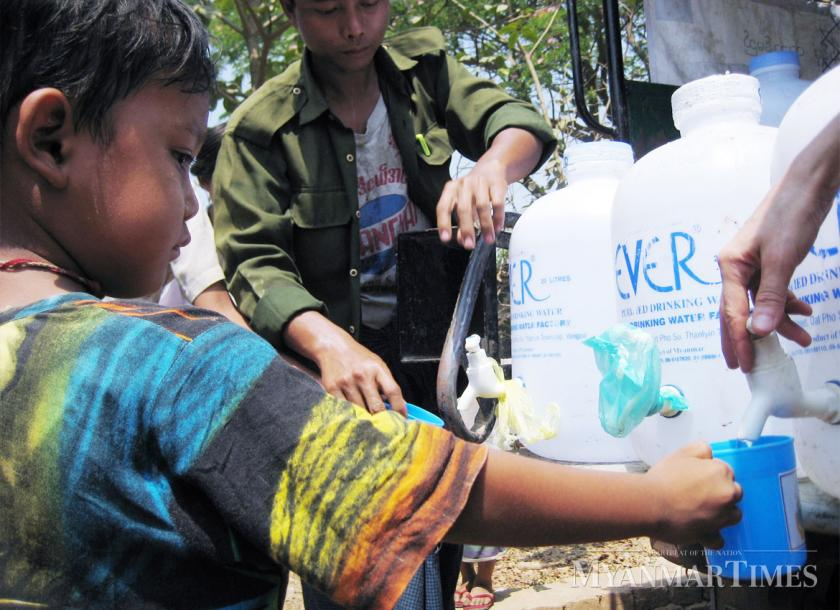 Boy gets free drinking water in Dala township, Yangon. The Myanmar Times