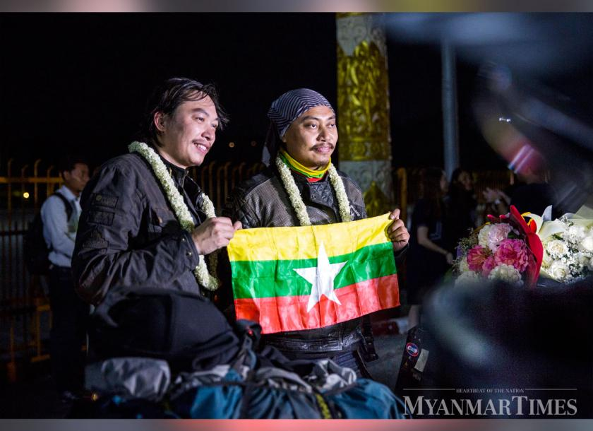 Sai Zom Pha (left) and Aung Kyaw Win pose with the Myanmar flag.