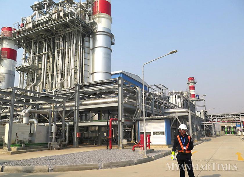 A security guard stands in front of the Sembcorp Myingyan combined-cycle gas turbine plant in Myingyan, Mandalay. Chan Mya Htwe/The Myanmar Times