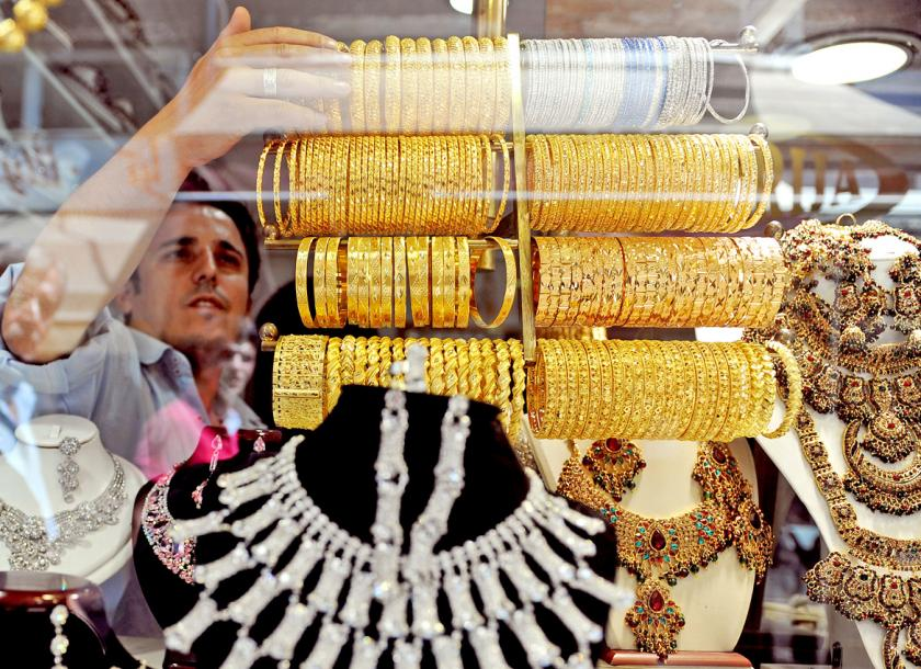 A Jewelry Worker Sets His Showcase In One Of The Many Gold S
