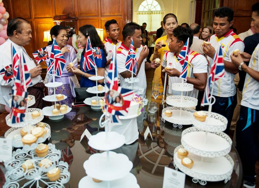 Myanmar paralympians eat elderflower cupcakes during the reception for the royal wedding at the British Ambassador's residence in Yangon. Aung Khant/The Myanmar Times