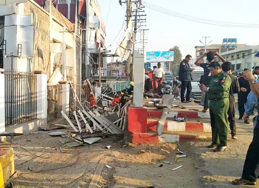 Explosion at bank in northern Myanmar kills 2, wounds 21
