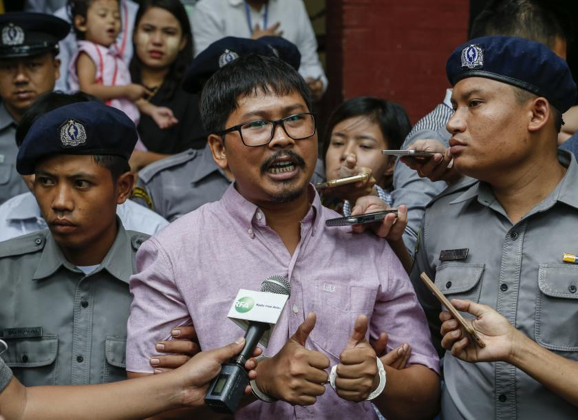 Reuters Journalists Charged with Obtaining State Secrets by Myanmar Court