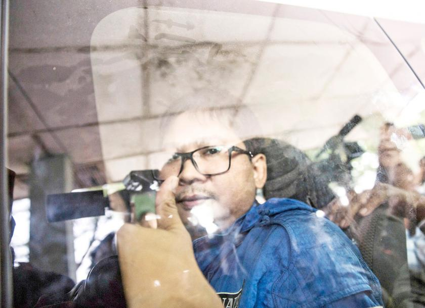 Wa Lone a journalist for the Reuters newswire arrives at a court in Yangon