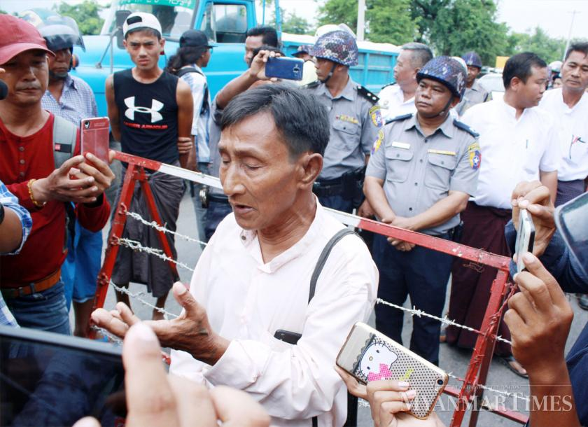A resident explain to reporters the reasons behind their protest. Si Thu Lwin/The Myanmar Times
