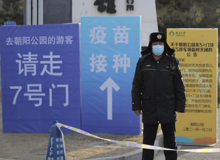 Chinese city of 11 million enters lockdown after coronavirus surge