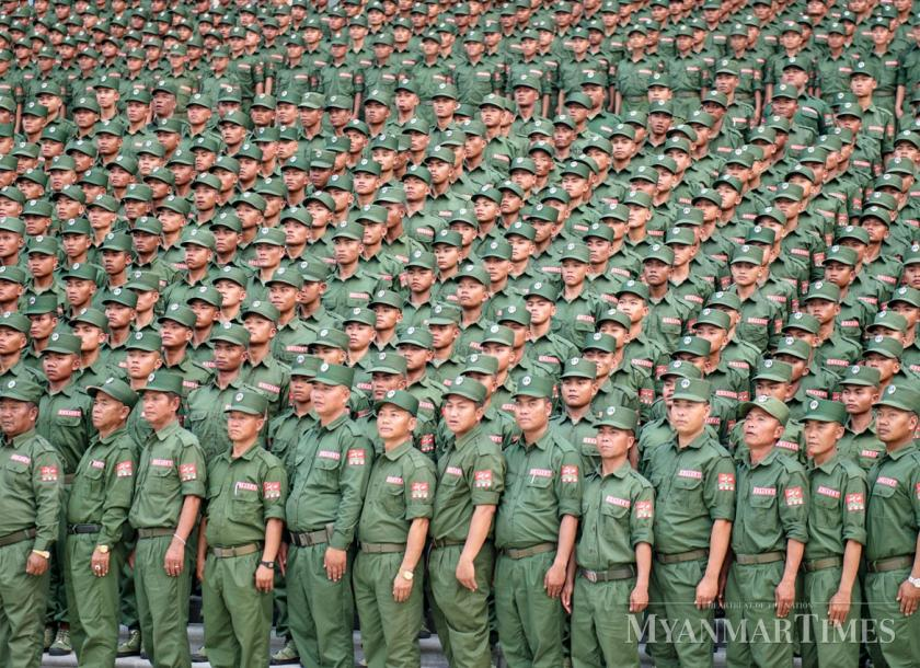 Members of the United Wa State Army gather during the group's anniversary ceremony earlier this year. Aung Khant/The Myanmar Times