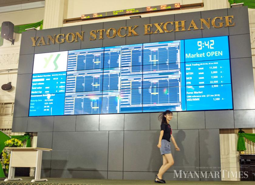 Policy and regulations allowing foreigners to trade on the YSX will be released by late August. Phoe Wa/The Myanmar Times