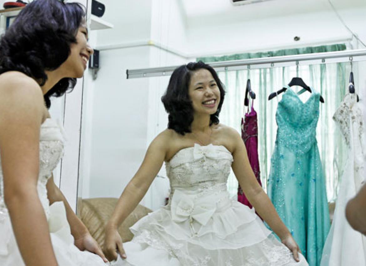 A Young Woman Tries New Wedding Dress Designed By 7 Picture Fashion In Yangon
