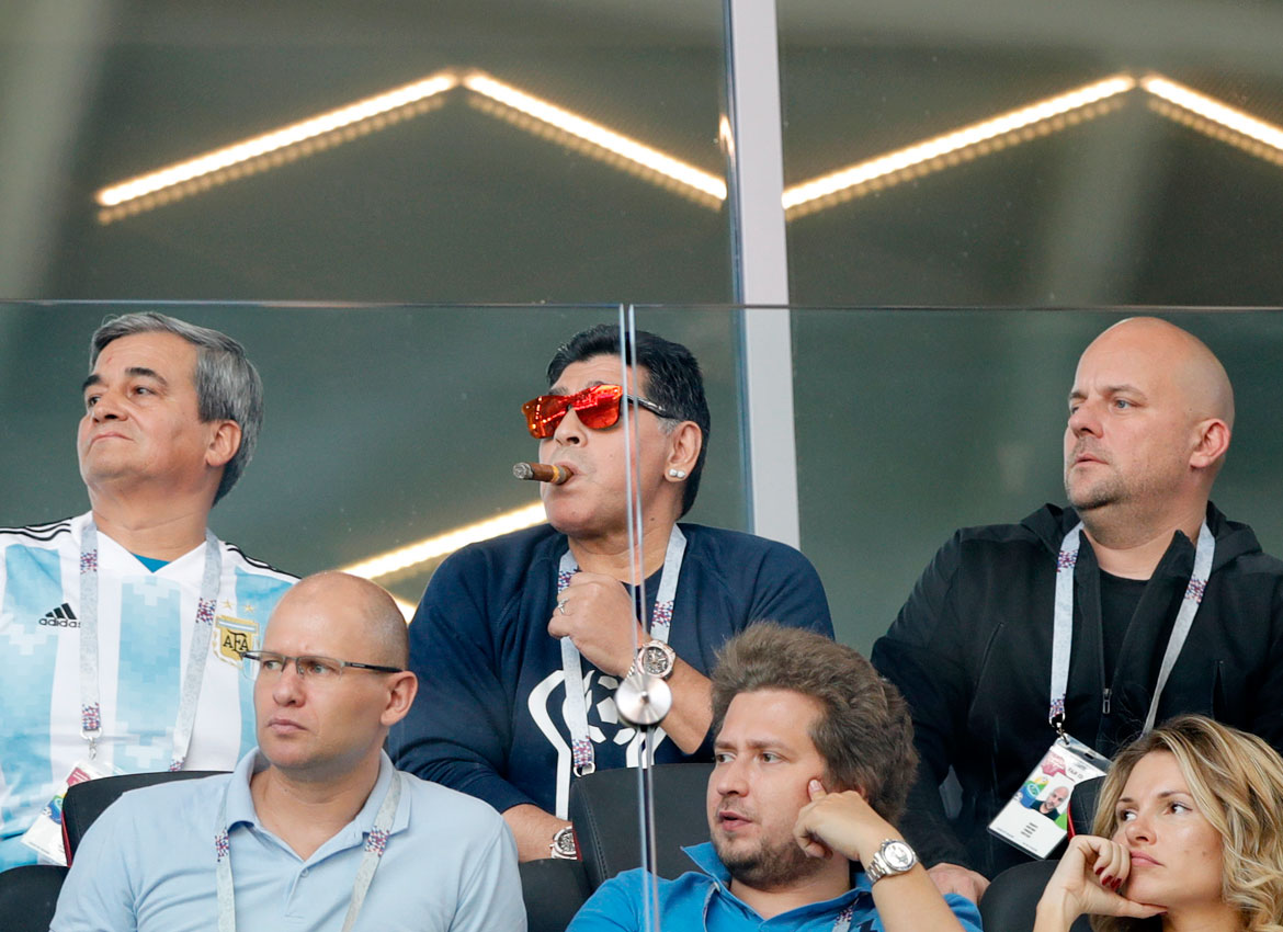 Former soccer star Diego Maradona center watches the group D match between Argentina and Iceland